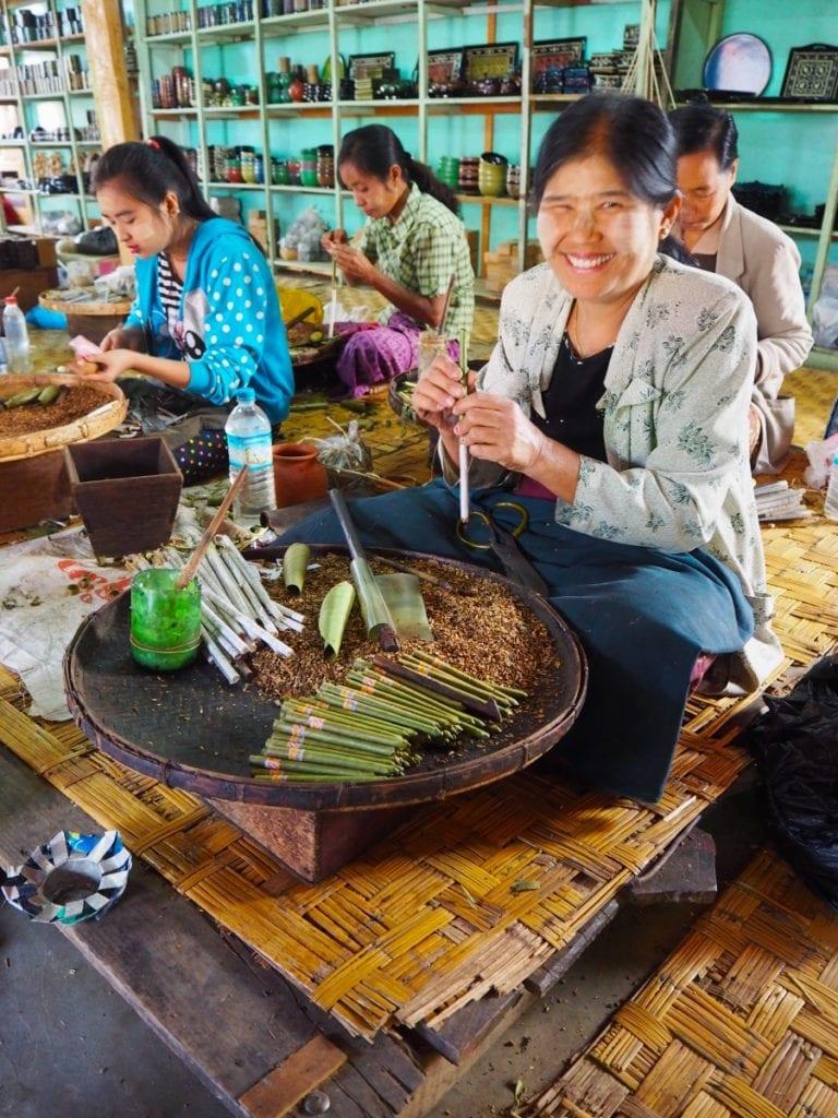 Burmese women rolling tobacco