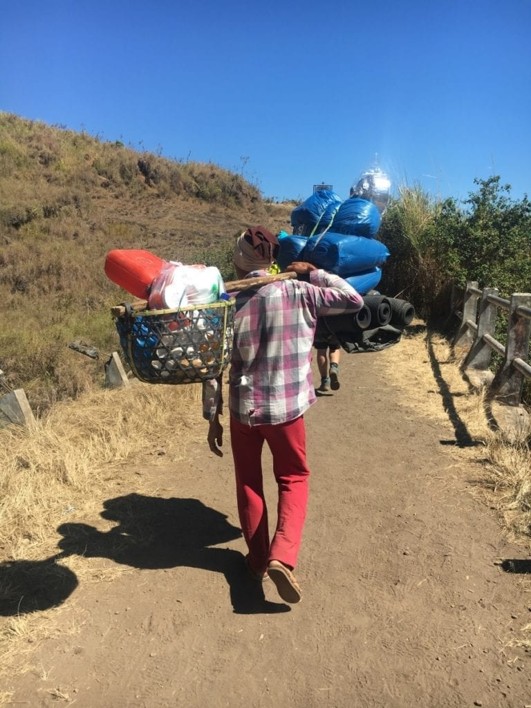 Porter carrying our supplies to our campsite