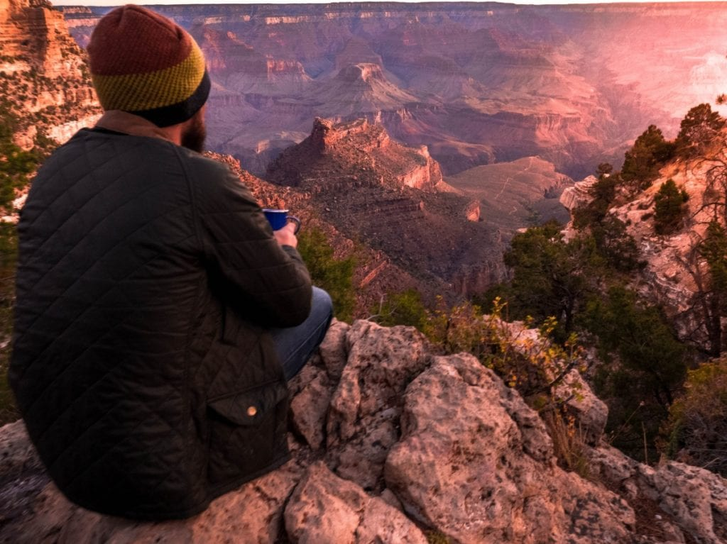 Man drinking coffee at Grand Canyon Sunrise