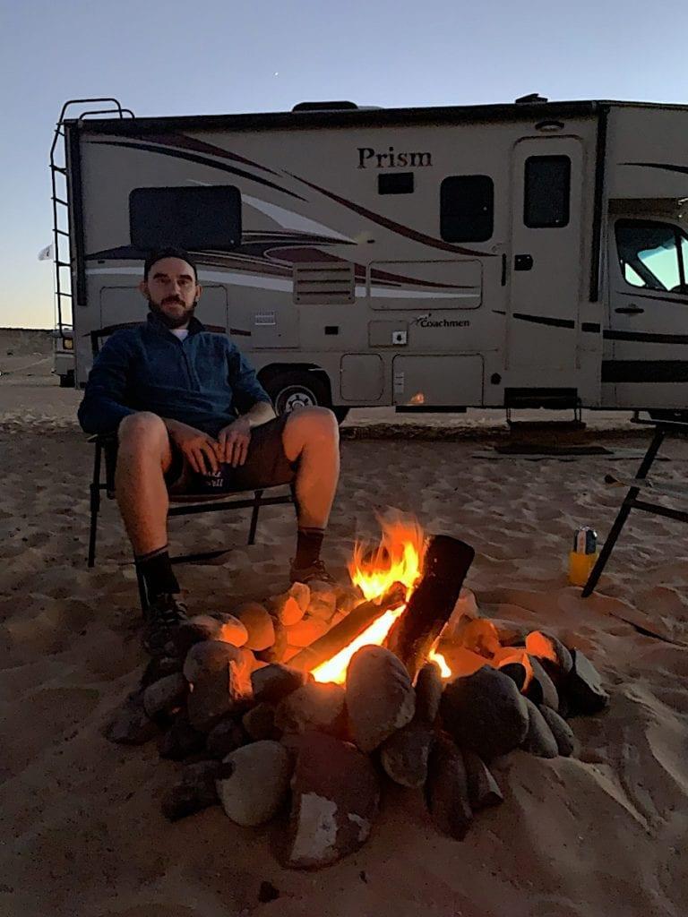 Man Watching Fire at Lake Powell, Arizona
