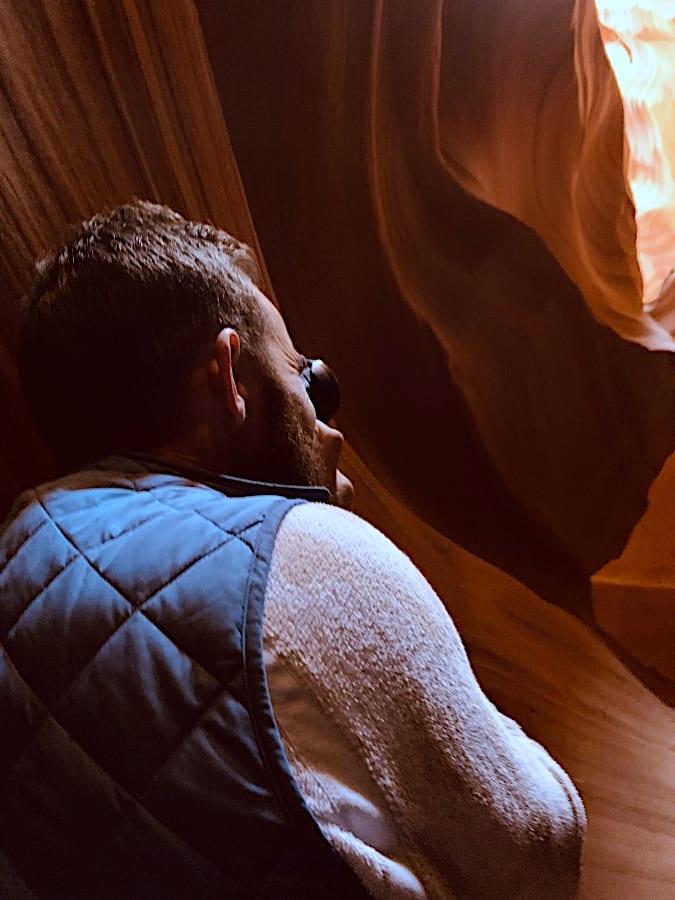 Jesse taking a photo of canyon